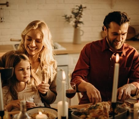 remortgaging family smiling at table