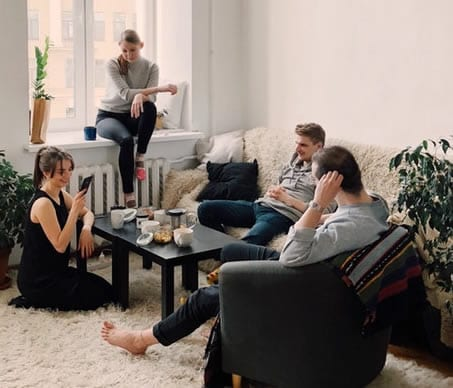 young first time home buyers sat in living room